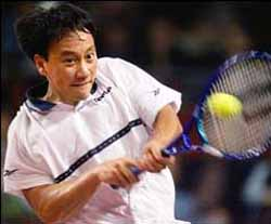 Michael Chang, of Mercer Island, Washington makes a return to Germany's Rainer Schuettler in their first round match at the ATP tennis tournament in the Hanns Martin Schleyer indoor arena in Stuttgart, Germany, Monday Oct. 25, 1999. (AP Photo/Thomas Kienzle)
